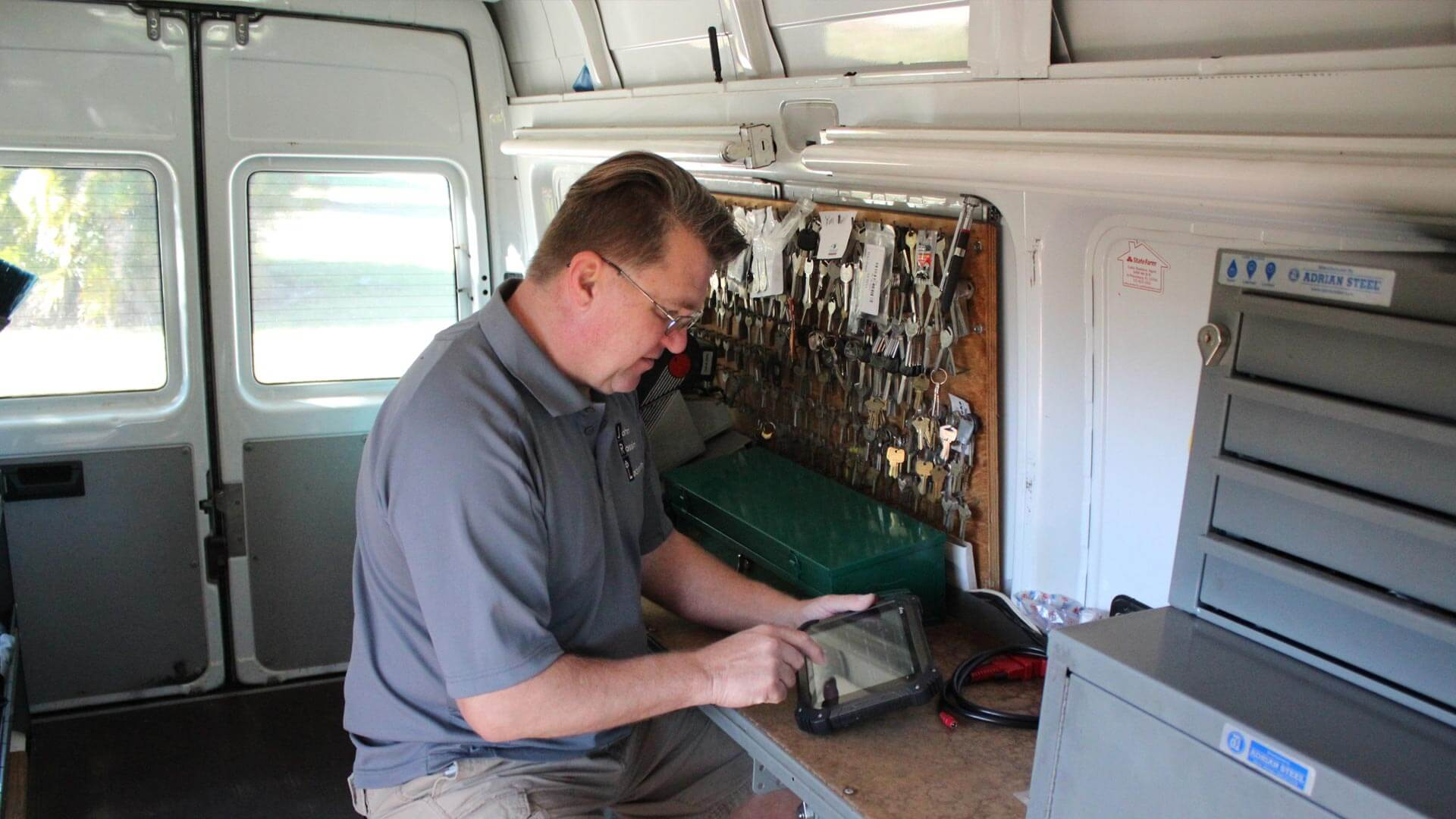 Local St. Petersburg, FL locksmith, John Rossin working in his mobile locksmith van.